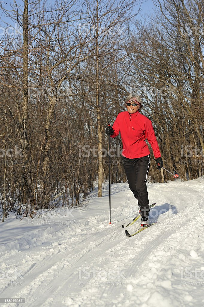 Woman, cross-country skiing, winter sport royalty-free stock photo