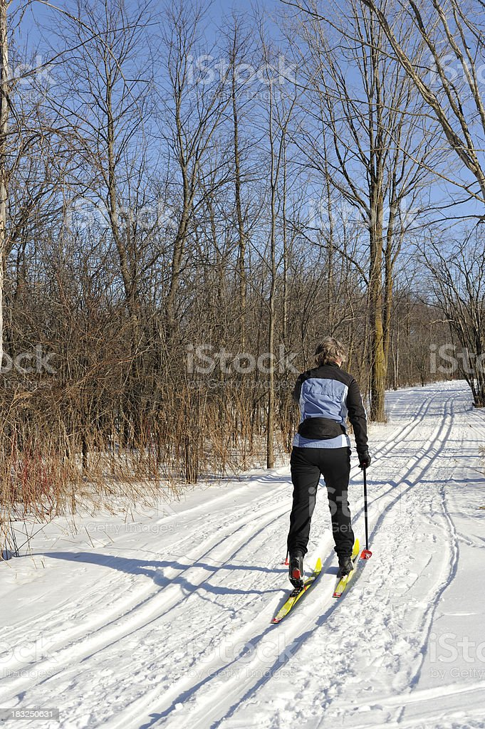 Woman, cross-country skiing, winter sport. royalty-free stock photo