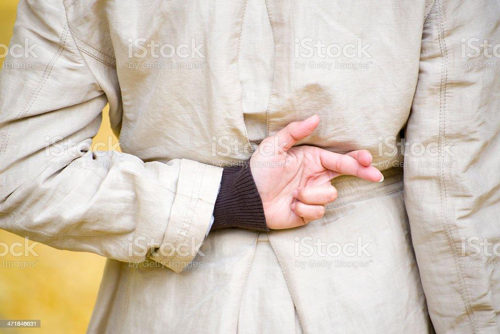 Woman crossing fingers stock photo
