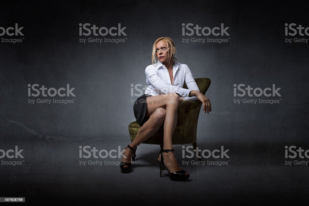 woman crossing legs with business dress stock photo