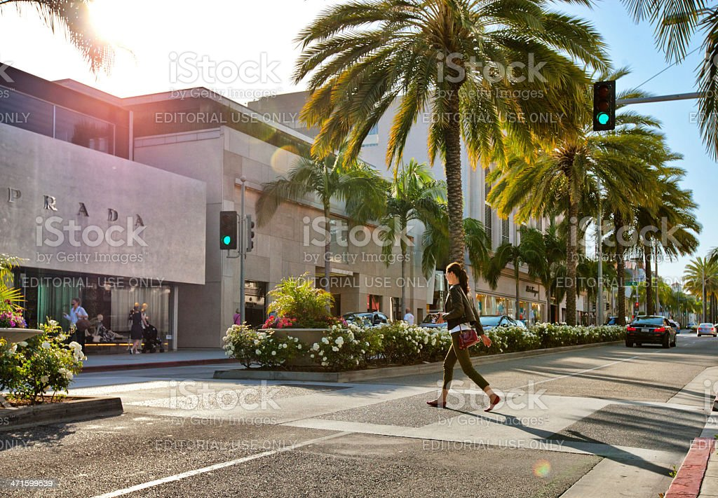 Woman crossing Rodeo Drive stock photo