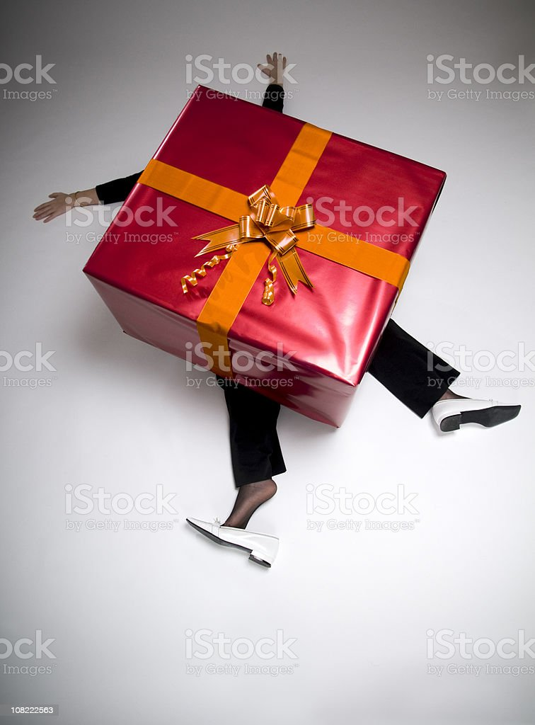 Woman Crushed Beneath Huge Wrapped Present royalty-free stock photo