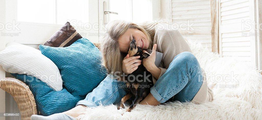 Woman cuddling her dog stock photo