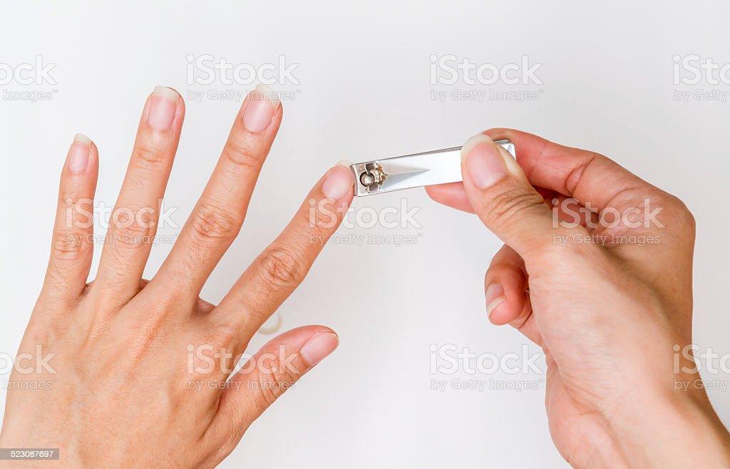 woman cut fingernail. stock photo