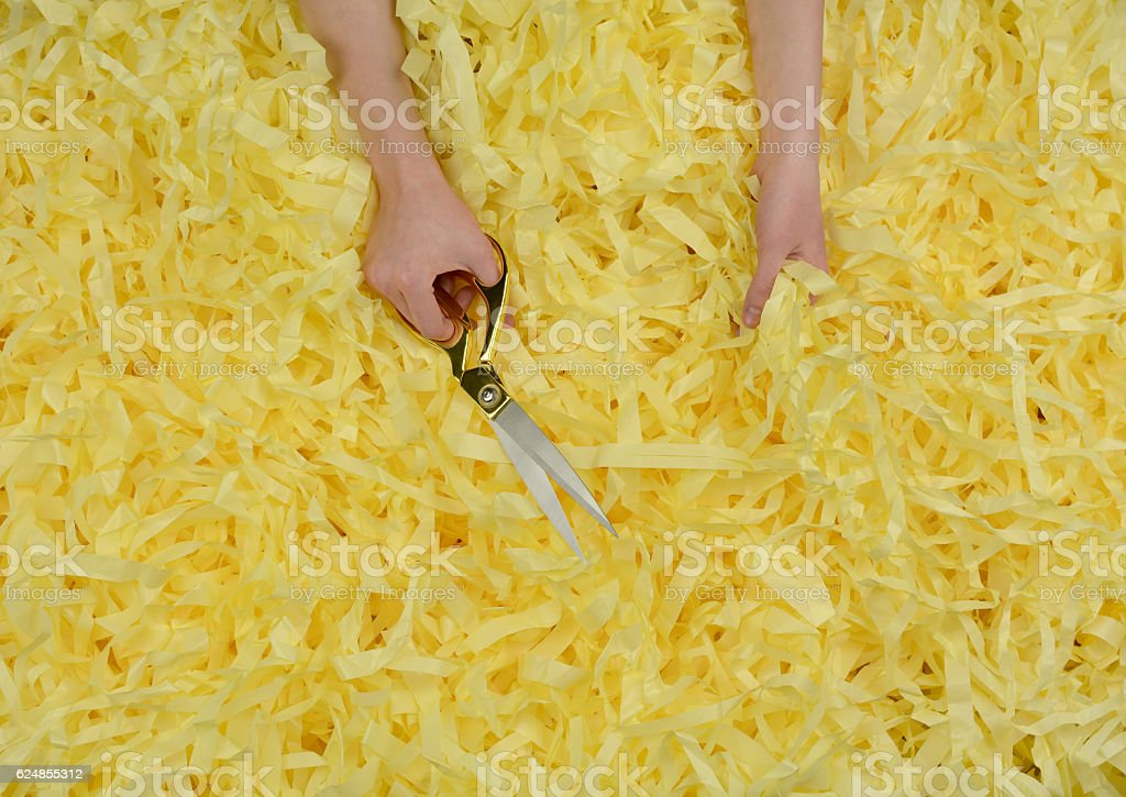 woman cuts the yellow paper stock photo