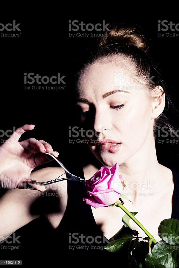 woman cutting a flower royalty-free stock photo