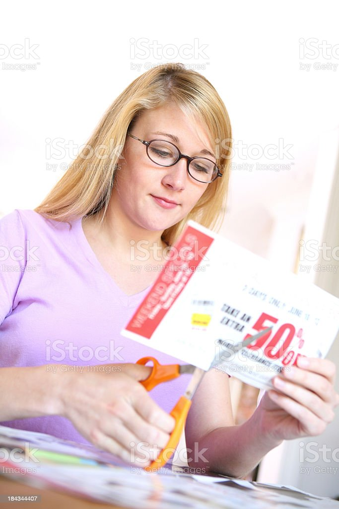 Woman Cutting Coupons stock photo