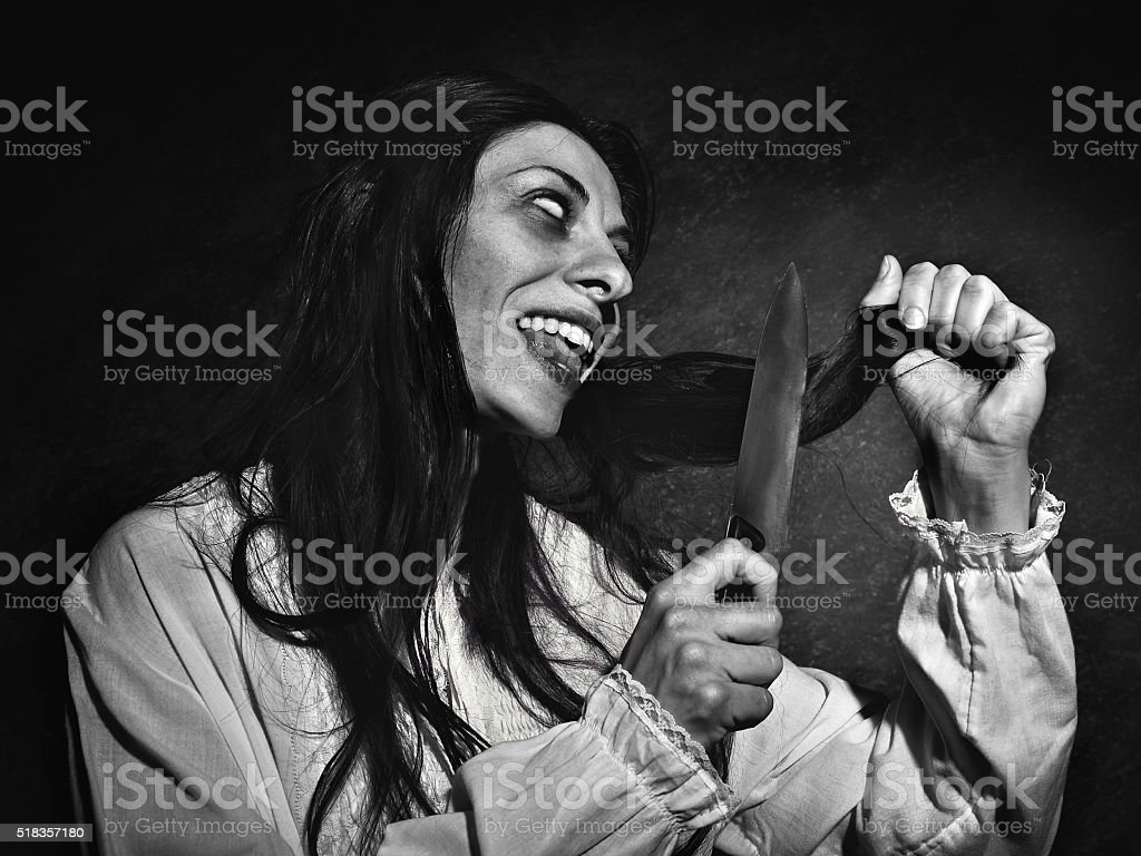 woman cutting hair before exorcism stock photo