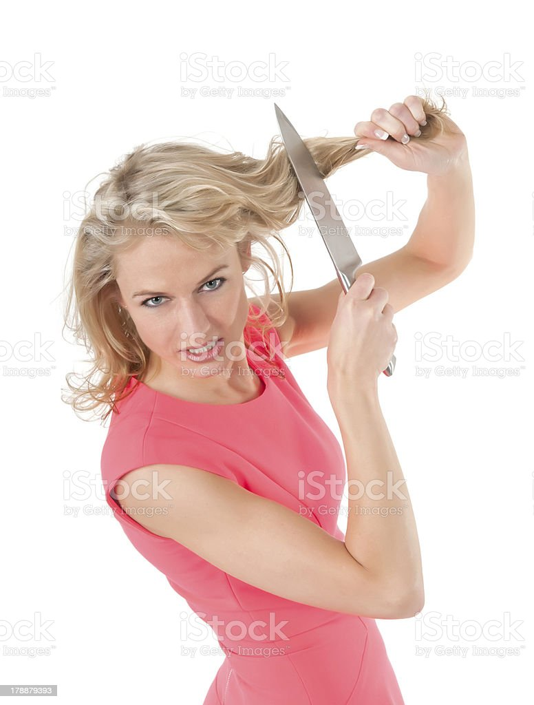 woman cutting hair with knife stock photo