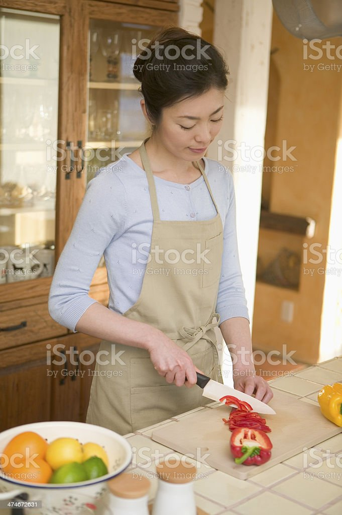 Woman cutting vegetables royalty-free stock photo