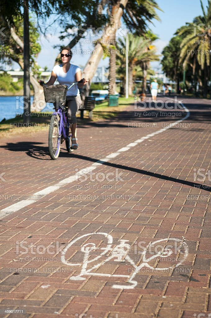 Israeli woman bicycling in Tel Aviv royalty-free stock photo