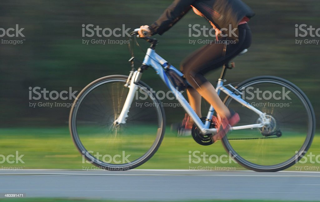 Woman Cycling - Blurred Motion royalty-free stock photo