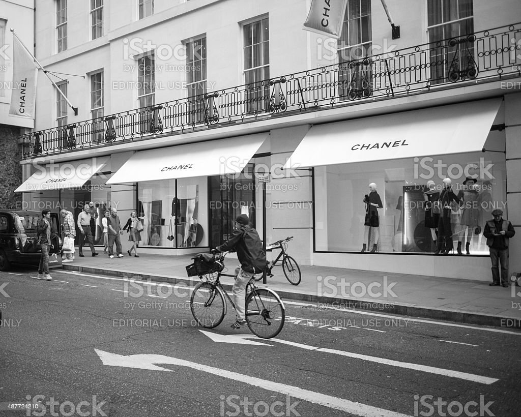 Woman cycling down New Bond Street, in Central London stock photo