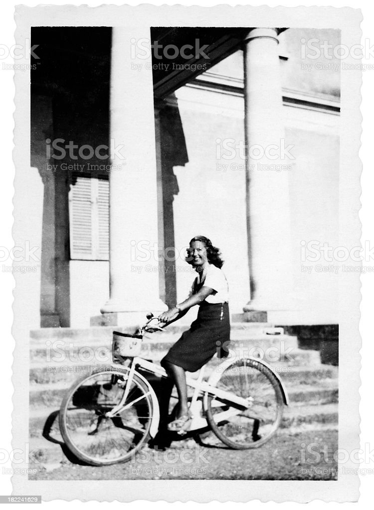 Woman Cycling in 1935 royalty-free stock photo