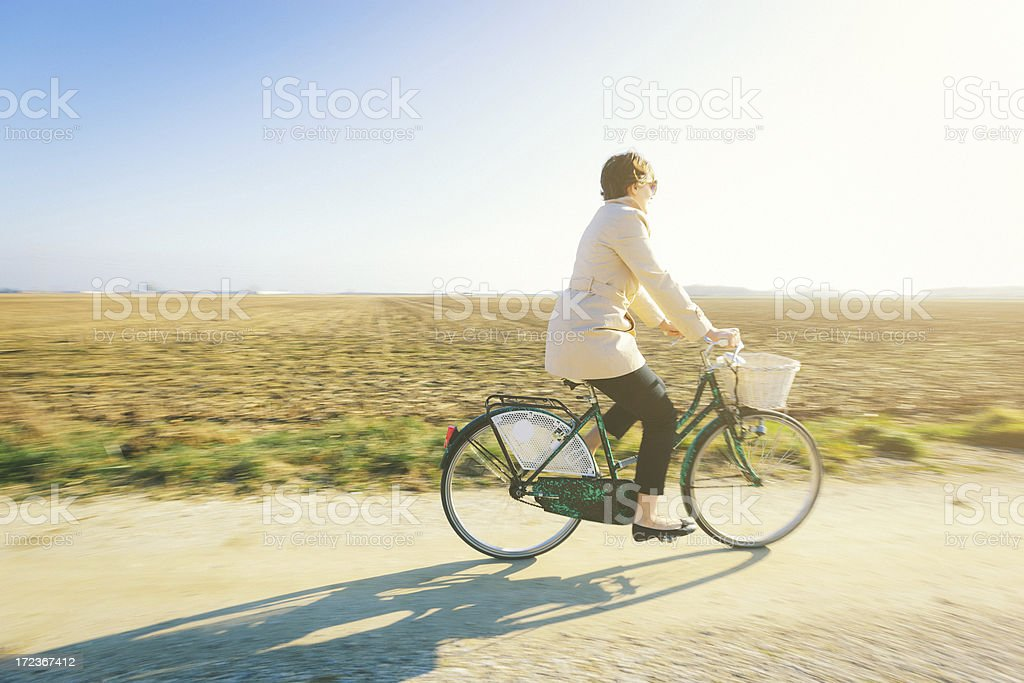 Woman cycling in the countryside royalty-free stock photo