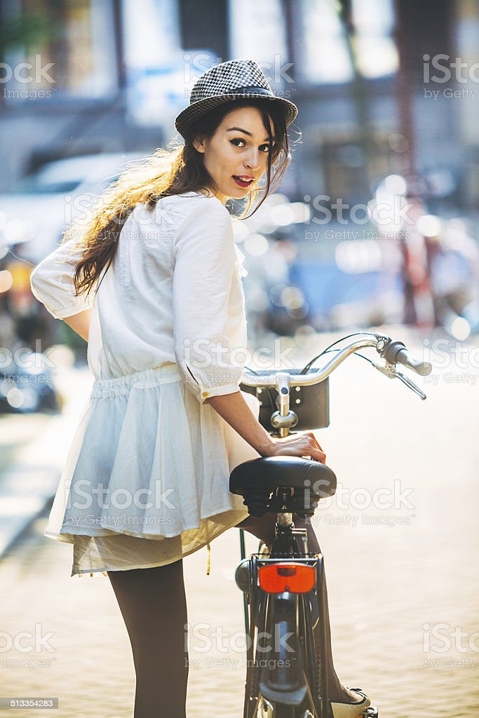 Woman cycling on the streets of Amsterdam. stock photo