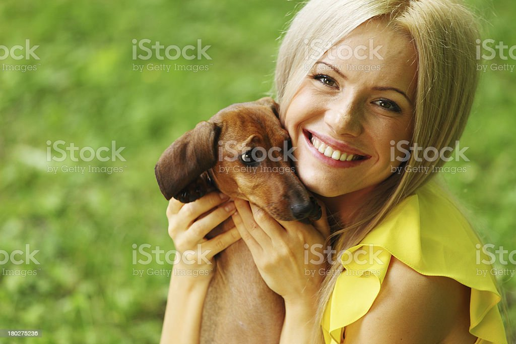 woman dachshund in her arms royalty-free stock photo