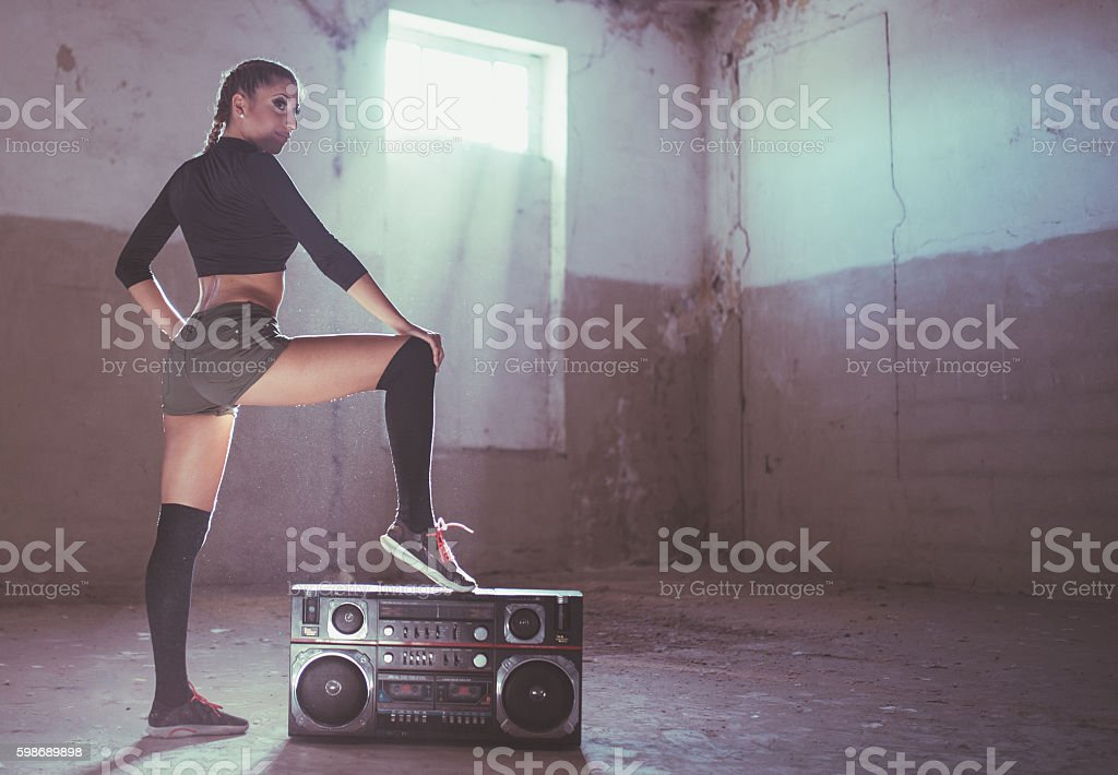 Woman dancer by radio stock photo