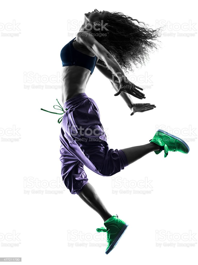 woman  dancer dancing exercises silhouette stock photo
