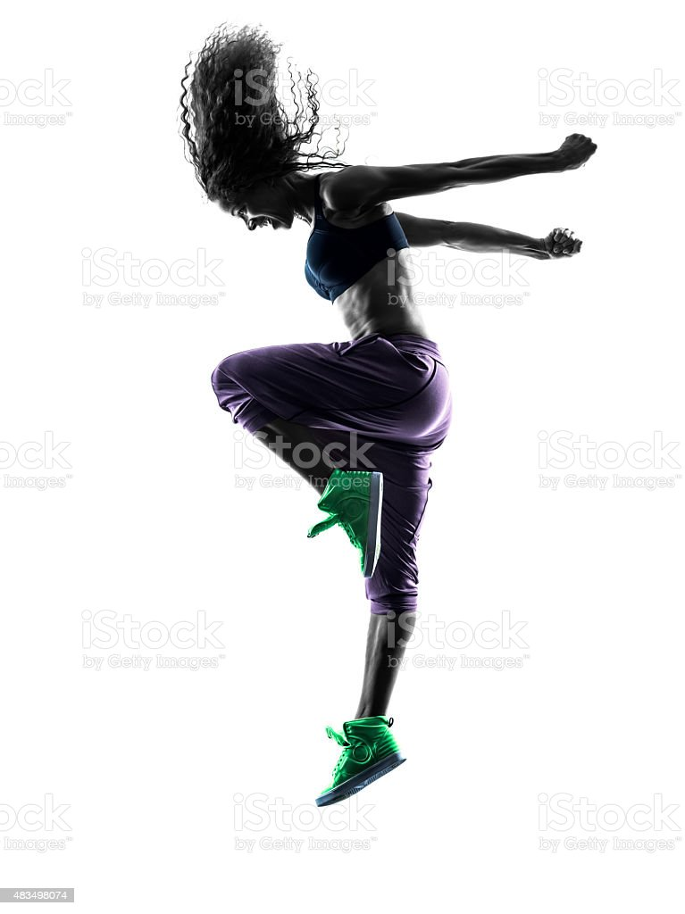 woman  dancer dancing exercises silhouette stock photo