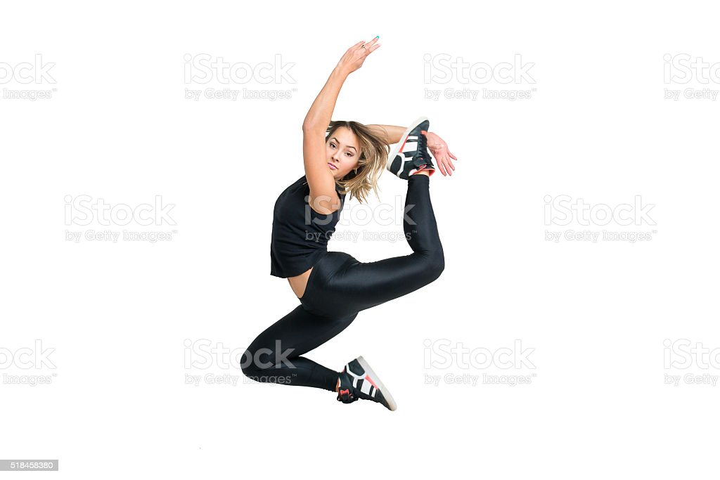 Woman dancer jumping isolated at white stock photo