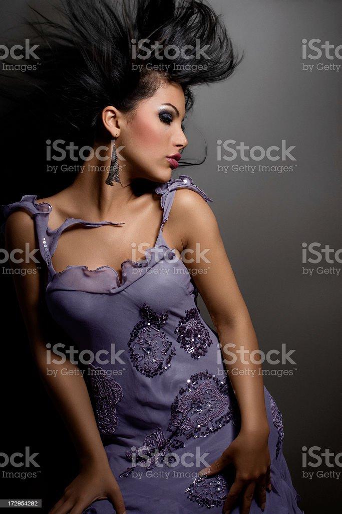 Woman dancer posing on dark background royalty-free stock photo