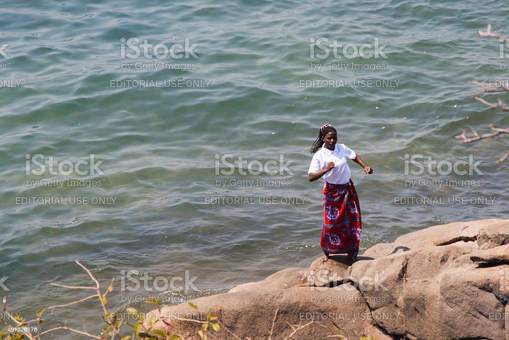 Woman dances at the beach. stock photo