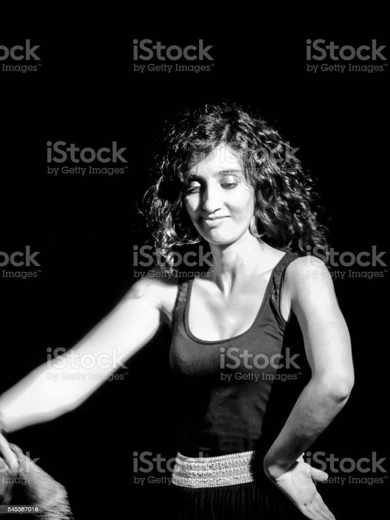 Woman dancing alone (black and white) stock photo
