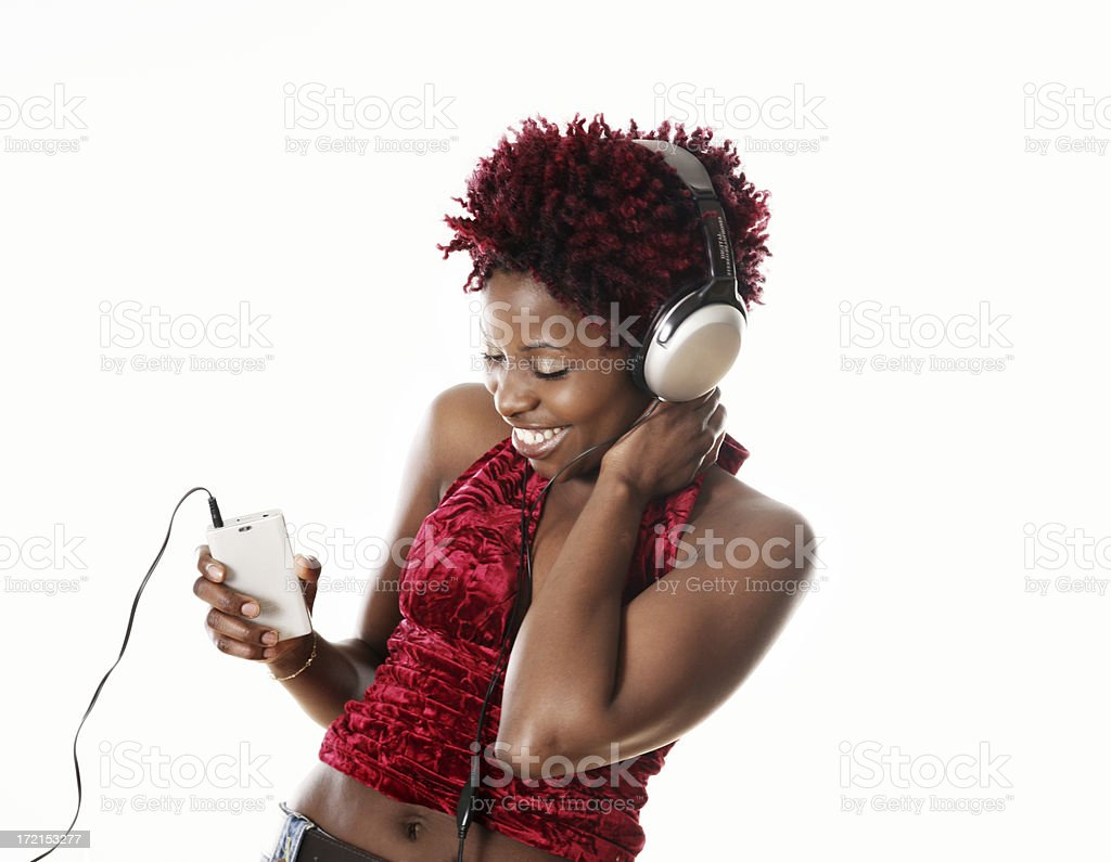 Woman dancing and listening music royalty-free stock photo