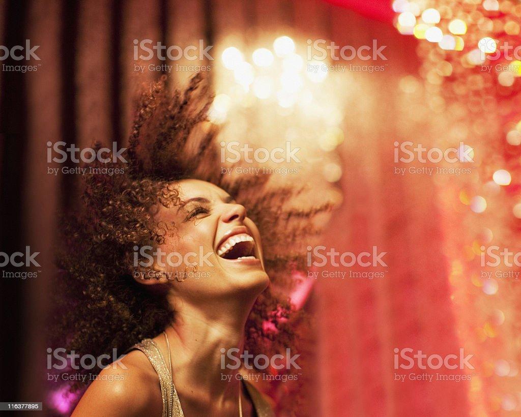 woman dancing at nightclub stock photo