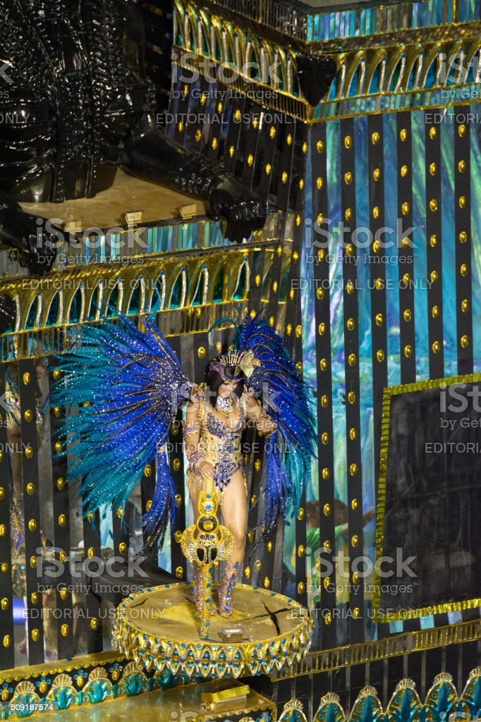 Woman dancing dressed in blue feathers royalty-free stock photo