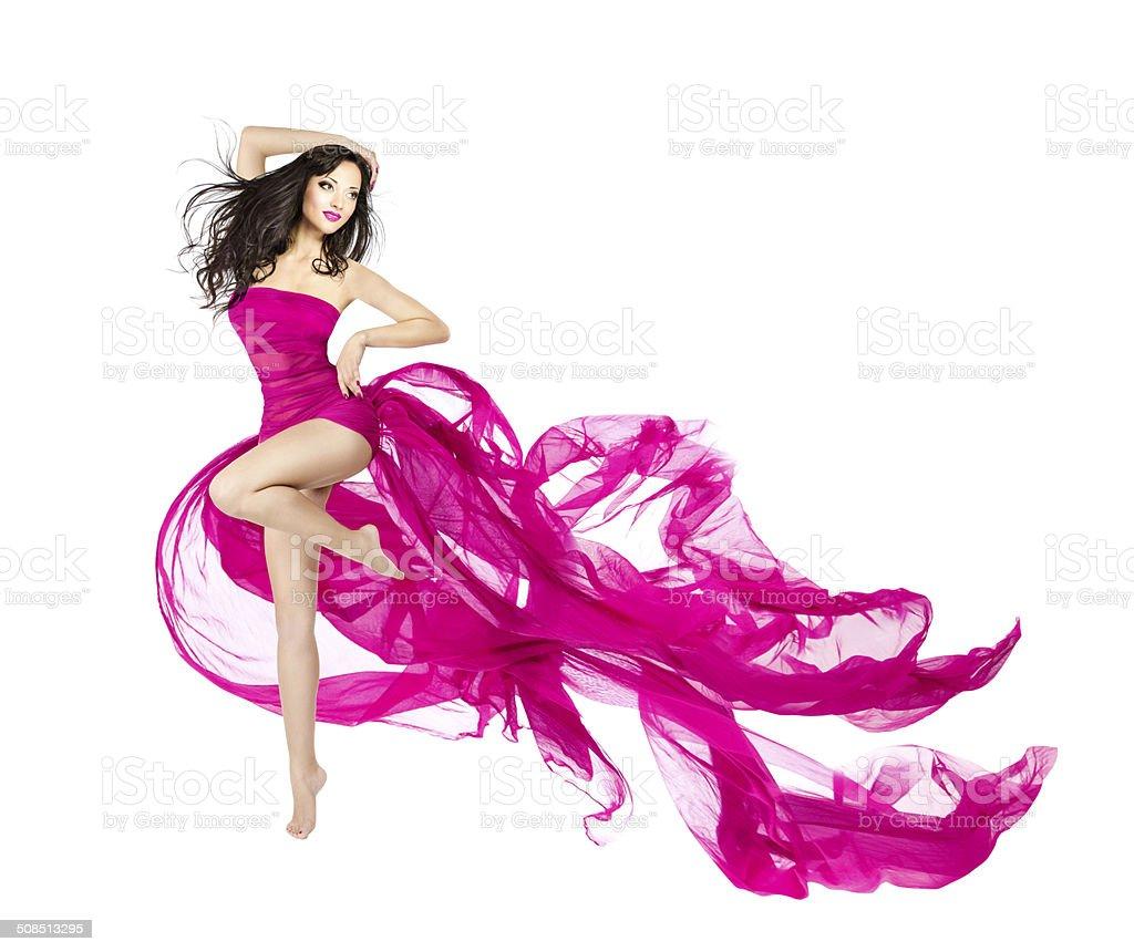 Woman dancing fluttering dress, fashion model dancer with waving fabric stock photo