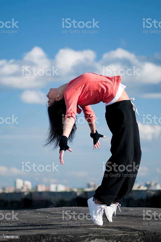 woman dancing hip hop over blue sky royalty-free stock photo