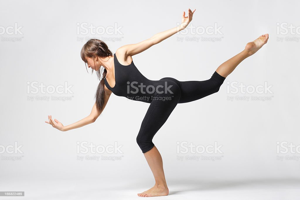 Woman dancing in a black leotard stock photo