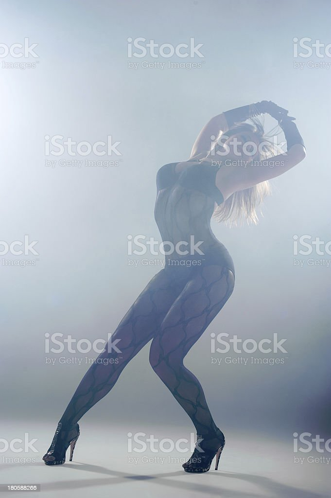 Woman dancing in a smoke. Studio royalty-free stock photo