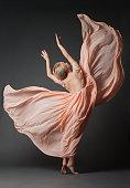 Woman dancing in light dress