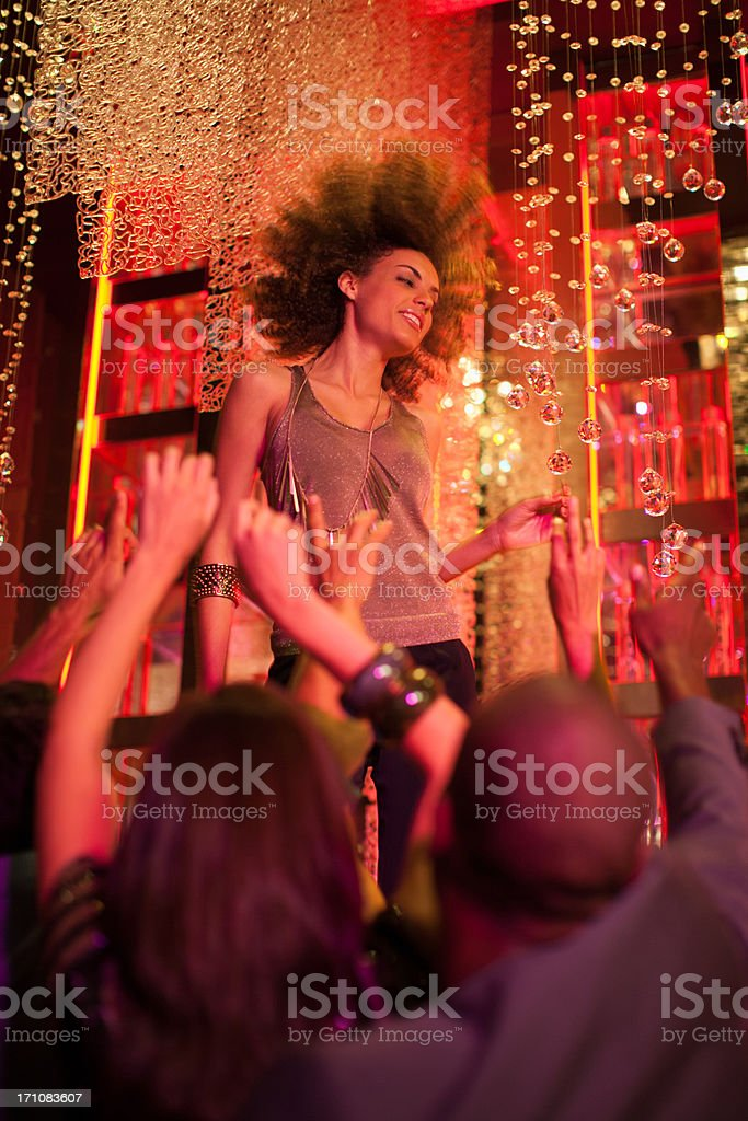 Woman dancing in nightclub stock photo