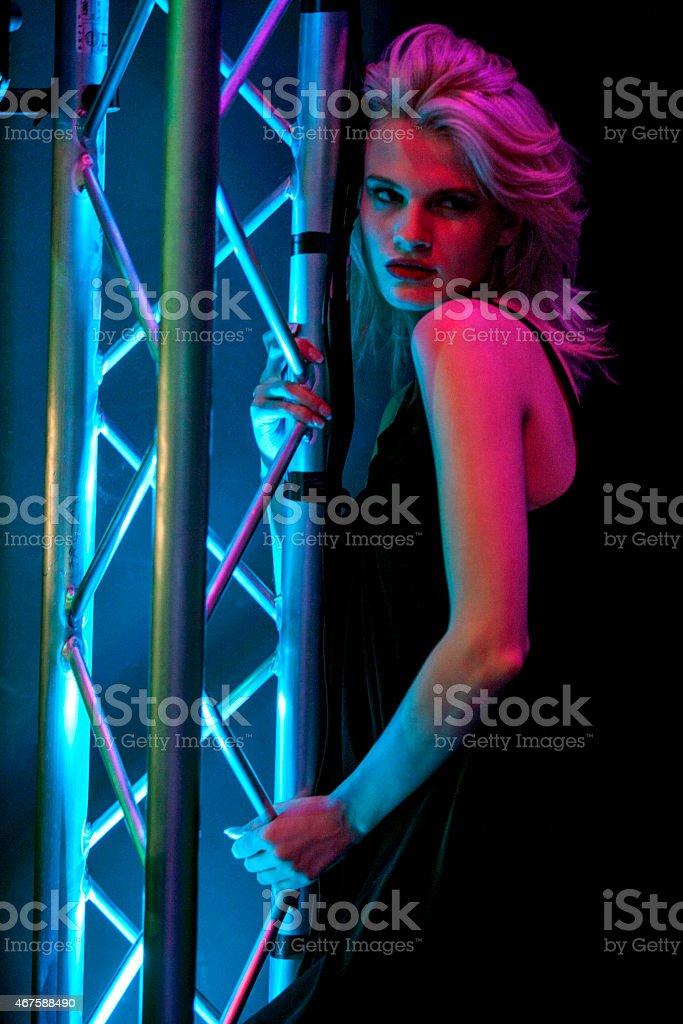 Woman dancing in nightclub stock photo