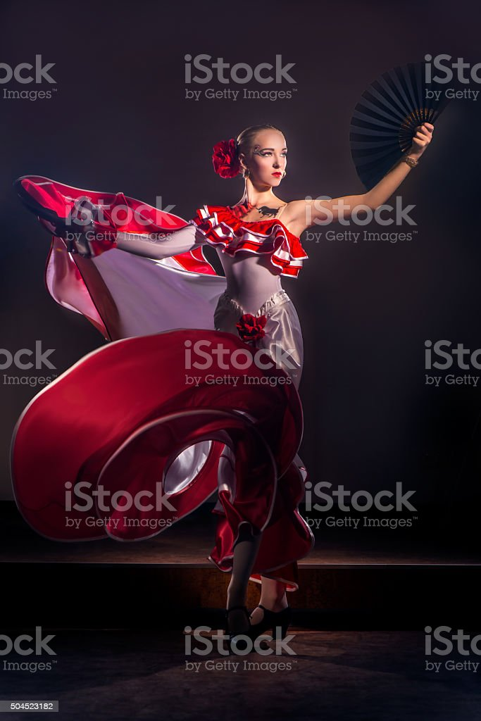 Woman dancing in red dress stock photo