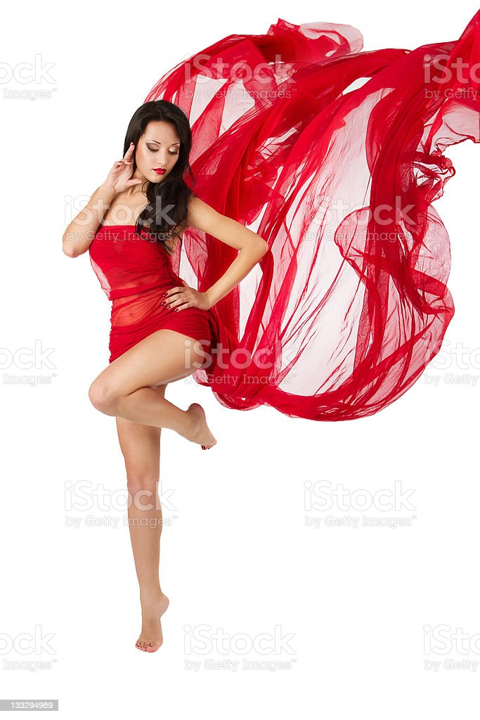 Woman dancing in red flying waving dress royalty-free stock photo