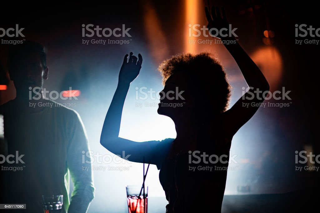 Woman dancing in the club stock photo