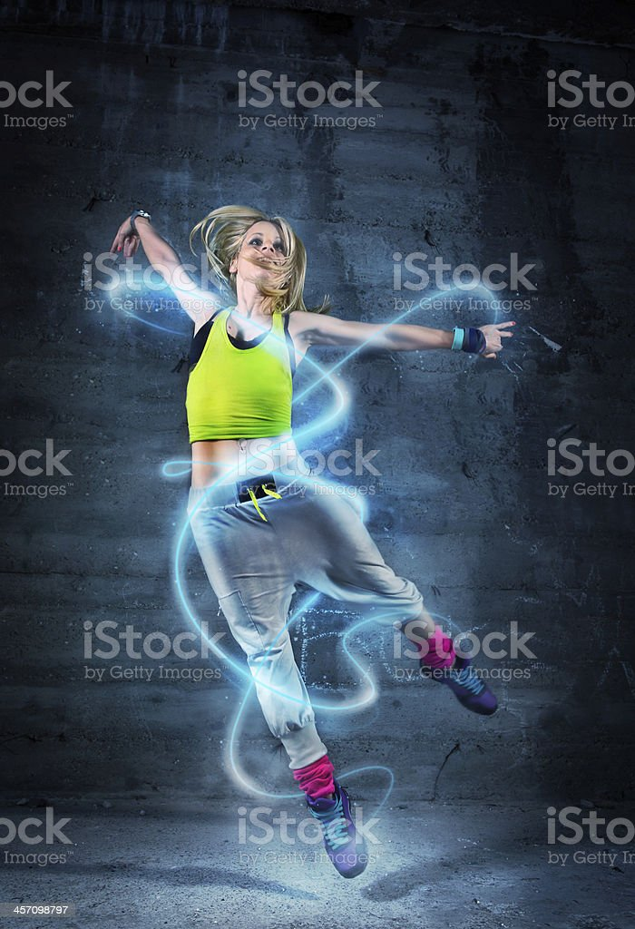 Woman dancing in urban environment with abstract lines stock photo