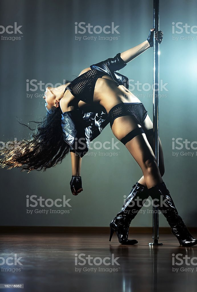 Woman dancing on stage with black boots  stock photo
