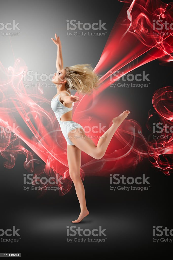 Woman dancing with flying fabric royalty-free stock photo