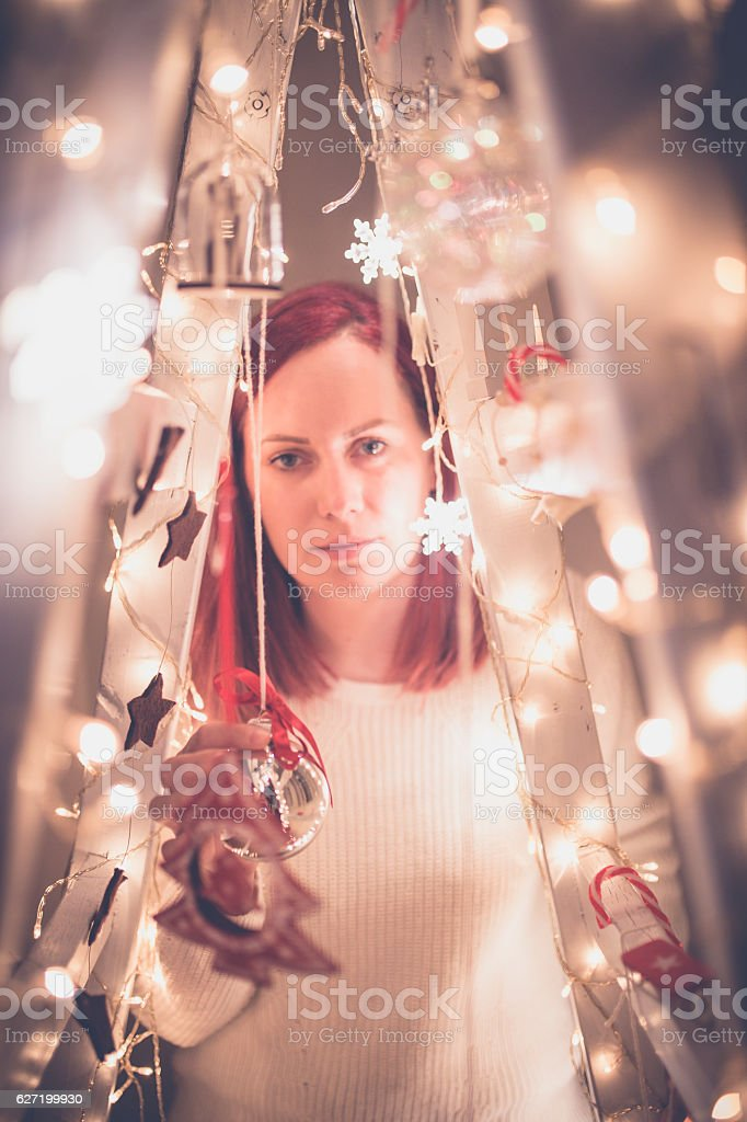 Woman decorates the interior of the house stock photo