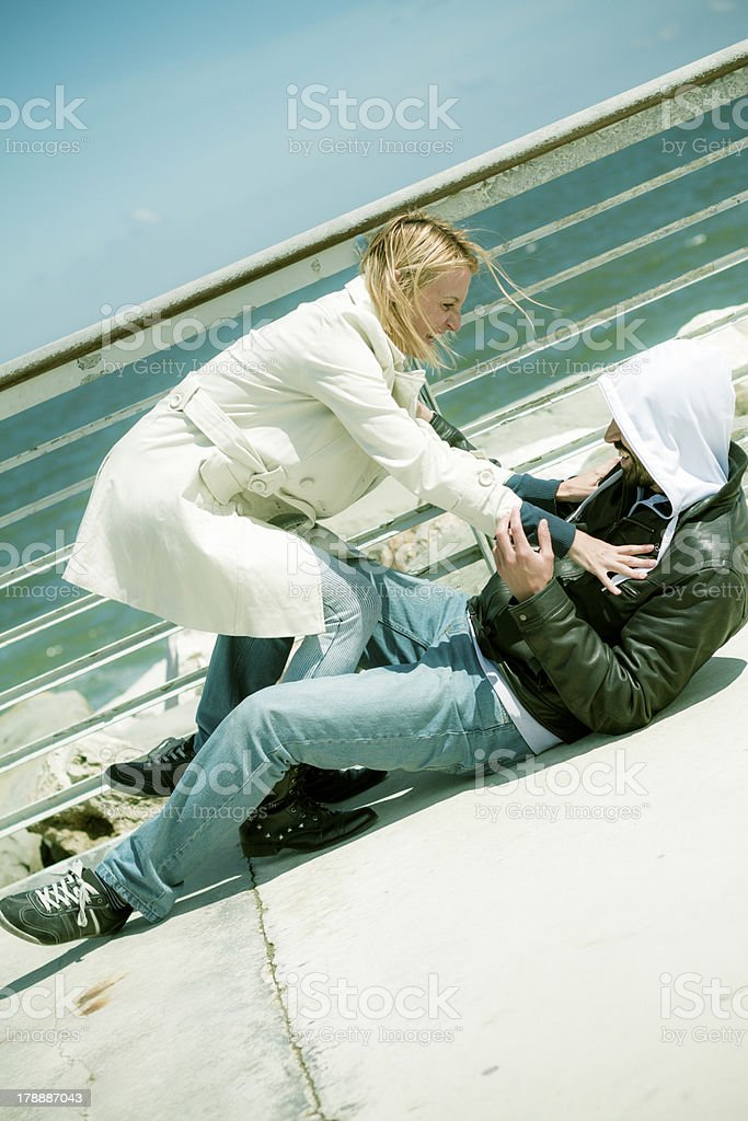 woman Defending Herself Against assailant royalty-free stock photo