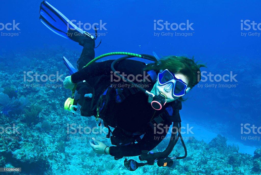 woman demonstrating diving skills stock photo
