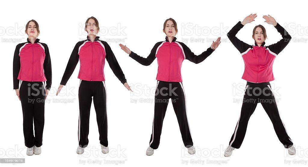 Woman Demonstrating Jumping Jacks stock photo