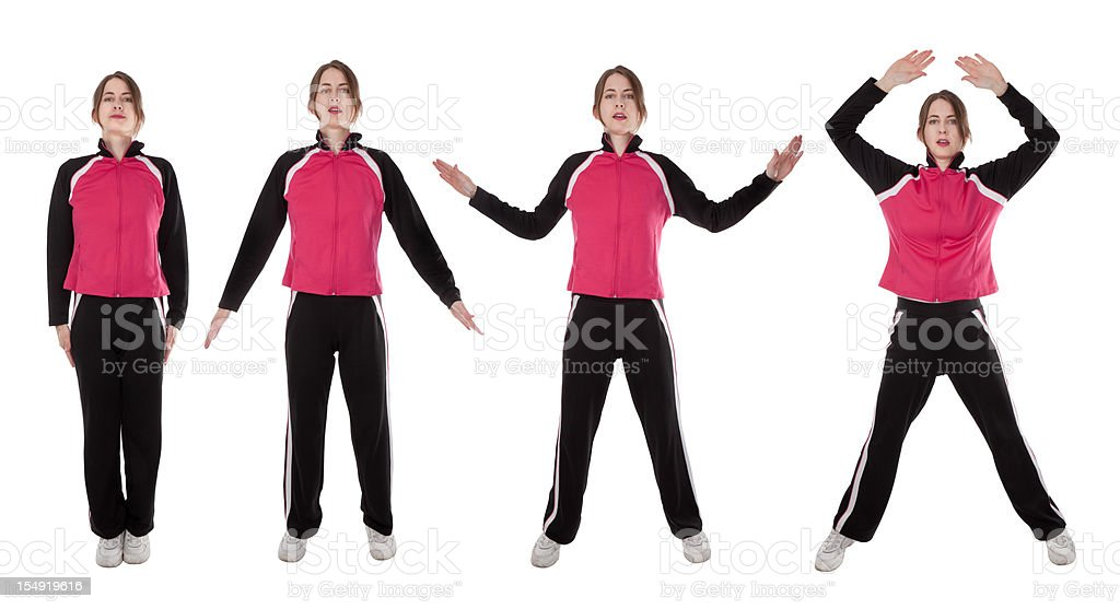 Woman Demonstrating Jumping Jacks stock photo