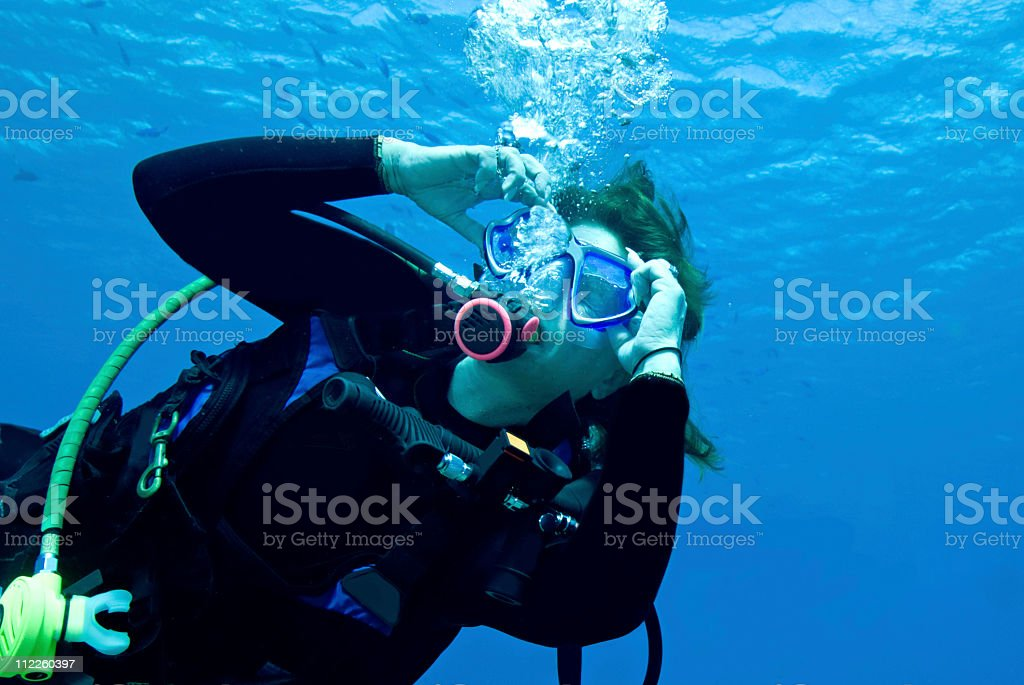 woman demonstrating mask clearing skills stock photo